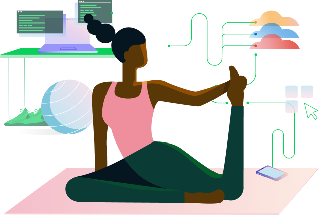 A woman on the floor stretching her leg in a yoga pose with a computer in the background